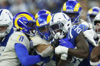Indianapolis Colts' Marlon Mack (25) is tackled by Los Angeles Rams' Darious Williams (11) and Kenny Young (41) during the second half of an NFL football game, Sunday, Sept. 19, 2021, in Indianapolis. (AP Photo/Michael Conroy)