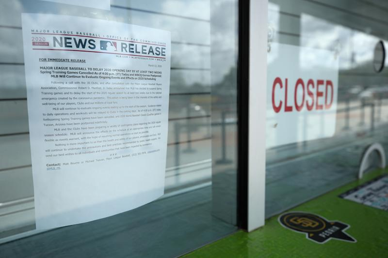 PEORIA, ARIZONA - MARCH 13: Closed signs and MLB news releases are displayed on box office windows outside of Peoria Stadium, home of the San Diego Padres and Seattle Mariners on March 13, 2020 in Peoria, Arizona. Major League Baseball cancelled spring training games and has delayed opening day by at least two weeks due to COVID-19. (Photo by Christian Petersen/Getty Images)
