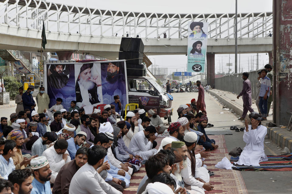 Supporters of Tehreek-e-Labiak Pakistan, a radical Islamist political party, pray while blocking a road during a sit-in protest against the arrest of their party leader Saad Rizvi, in Lahore, Pakistan, Wednesday, April 14, 2021. Pakistani security forces swinging batons and firing teargas moved before dawn Wednesday to clear sit-ins by protesting Islamists in the garrison city of Rawalpindi and elsewhere after five people died in earlier clashes, officials said. (AP Photo/K.M. Chaudary)