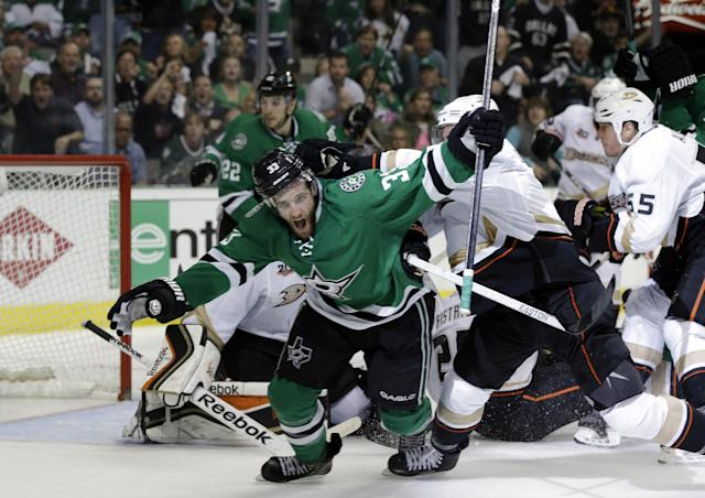 Dallas Stars defenseman Alex Goligoski (33) celebrates his goal against the Anaheim Ducks in the third period of Game 4 of a first-round NHL hockey Stanley Cup playoff series, Wednesday, April 23, 2014, in Dallas. The Stars won 4-2. (AP Photo/Tony Gutierrez)