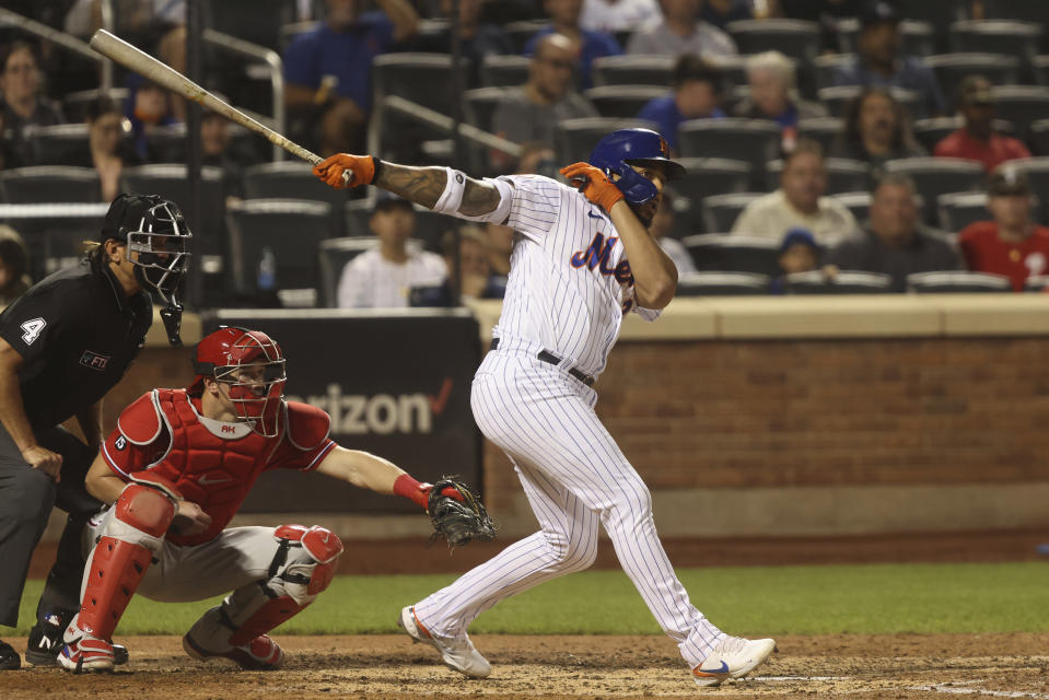 New York Mets' Dominic Smith hits a two-run double during the fifth inning of a baseball game against the Philadelphia Phillies, Sunday, Sept. 19, 2021, in New York. (AP Photo/Jason DeCrow)