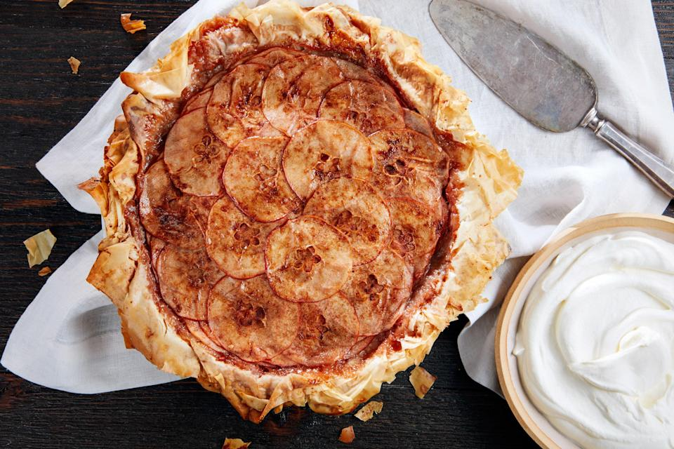 "It's all about the layers and ruffles in this dramatic and delicate apple pie. You can buy phyllo pastry in the freezer aisle; you'll brush each sheet with butter and sprinkle with cinnamon sugar. <a href=""https://www.epicurious.com/recipes/food/views/layered-apple-pie-with-phyllo-crust-56390160?mbid=synd_yahoo_rss"" rel=""nofollow noopener"" target=""_blank"" data-ylk=""slk:See recipe."" class=""link rapid-noclick-resp"">See recipe.</a>"