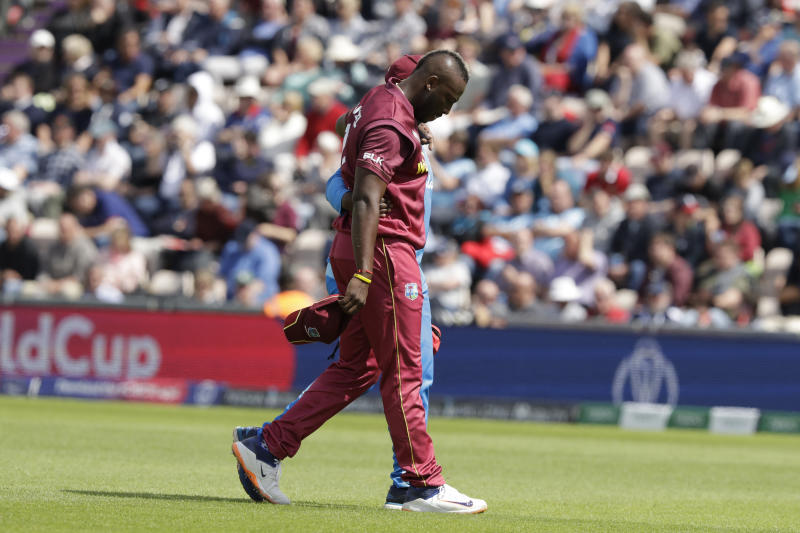 West Indies' Andre Russell walks off the field of play with an injury after bowling during the Cricket World Cup match between England and West Indies at the Hampshire Bowl in Southampton, England, Friday, June 14, 2019. (AP Photo/Matt Dunham)