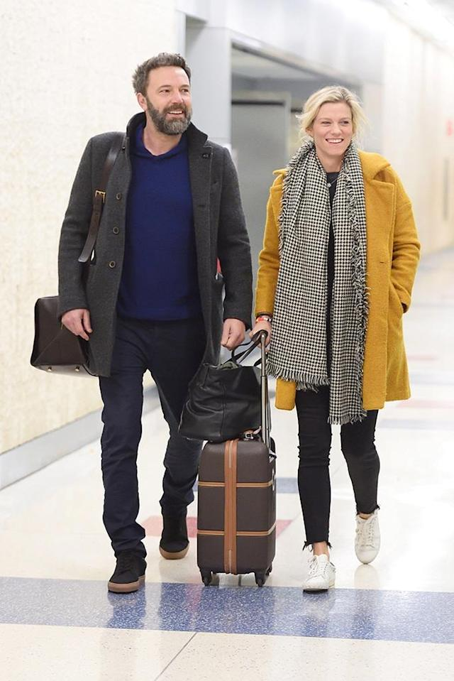<p>The couple looked happy to be together as they arrived with smiles at JFK airport in NYC on Wednesday. The twosome stopped for some doughnuts, smiling and laughing along the way. (Photo: Backgrid) </p>