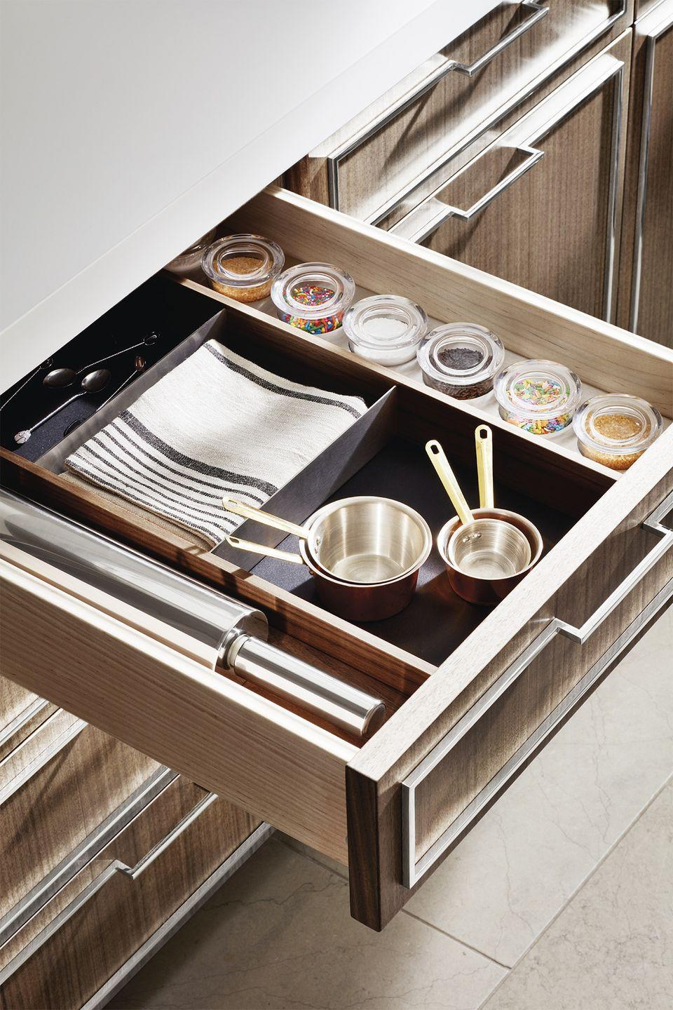 <p>Group similar items into categories, you can find exactly what you need in a pitch. In this case, the most-used baking tools were kept together, along with a range of sprinkles and sugars for decorating sweet treats. </p>