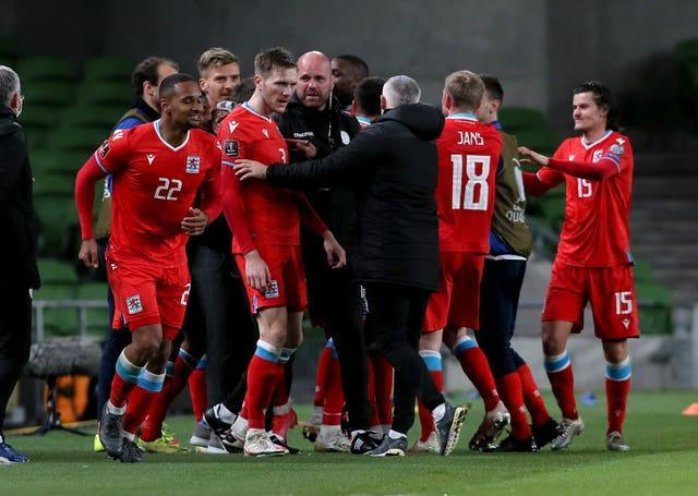 Luxembourg players and staff celebrate in Dublin