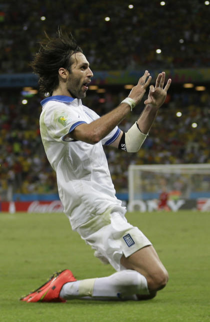 Greece's Giorgos Samaras celebrates scoring his side's second goal during the group C World Cup soccer match between Greece and Ivory Coast at the Arena Castelao in Fortaleza, Brazil, Tuesday, June 24, 2014. (AP Photo/Natacha Pisarenko)