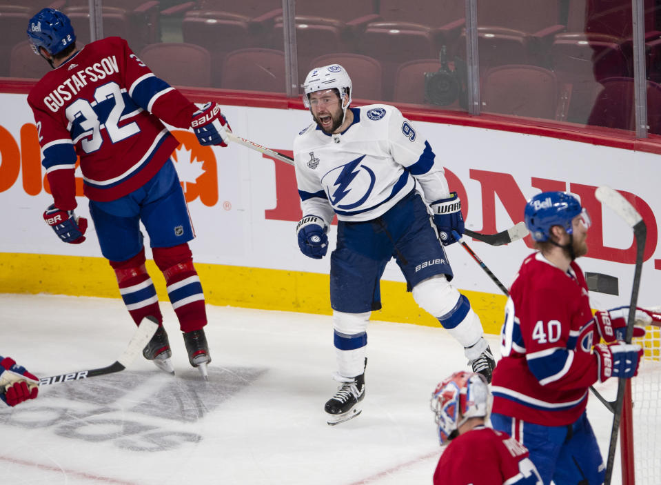 Tampa Bay Lightning center Tyler Johnson (9) celebrates after scoring against the Montreal Canadiens during the third period of Game 3 of the NHL hockey Stanley Cup Final, Friday, July 2, 2021, in Montreal. (Ryan Remiorz/The Canadian Press via AP)