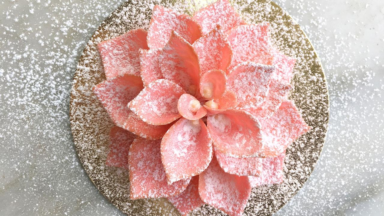 "<p>Designed to be eaten petal-by-petal, this beautiful blossom is made of more than 20 individual hand-made rose honey tuile ""petals,"" each of which is filled with <a rel=""nofollow"" href=""http://www.foodandwine.com/slideshows/lychee-cocktails"">lychee</a> ganache and finished with a dusting of powdered sugar.</p>"