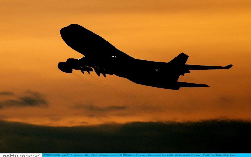 A passenger jet takes off from Heathrow airport - Peter Macdiarmid