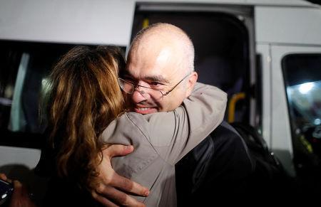 Swedish citizen Ali Gharavi reacts after being released from prison outside the Silivri prison complex near Istanbul, Turkey, October 26, 2017. REUTERS/Osman Orsal