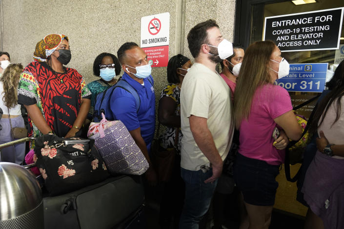 Passengers wait in a long line to get a COVID-19 test to travel overseas at Fort Lauderdale-Hollywood International Airport, Friday, Aug. 6, 2021, in Fort Lauderdale, Fla. Recent flight cancelations caused many passengers to redo their tests while others were unable to get the test locally due to long lines caused by the surge of the Delta variant. (AP Photo/Marta Lavandier)