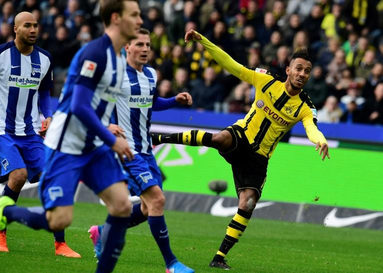 Dortmund's forward Pierre-Emerick Aubameyang (R) reacts after scoring during the German First division Bundesliga football match of Hertha Berlin vs Borussia Dortmund in Berlin, Germany, on March 11, 2017