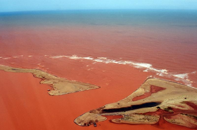 Brazil's government says it will sue mining giants BHP Billiton and Vale for $5.2 billion in clean-up costs and damages after the deadly collapse of a waste water dam at an iron-ore mine (AFP Photo/Fred Loureido )