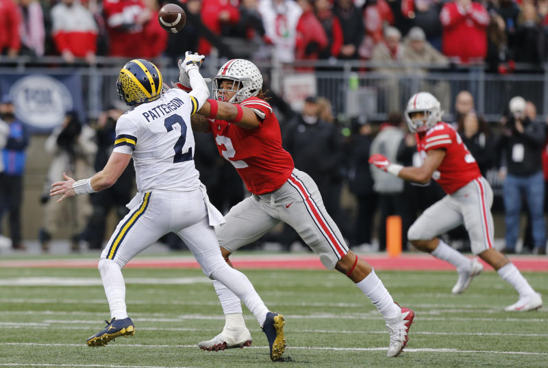 Ohio State defensive end Chase Young, right, pressures Michigan quarterback Shea Patterson during the second half of an NCAA college football game Saturday, Nov. 24, 2018, in Columbus, Ohio. Ohio State beat Michigan 62-39. (AP Photo/Jay LaPrete)