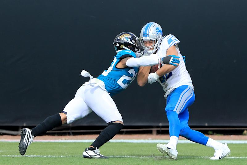 T.J. Hockenson of the Detroit Lions catches a touchdown pass against Josh Jones (29) of the Jacksonville Jaguars during the third quarter in the game at TIAA Bank Field on Oct. 18, 2020 in Jacksonville, Florida.