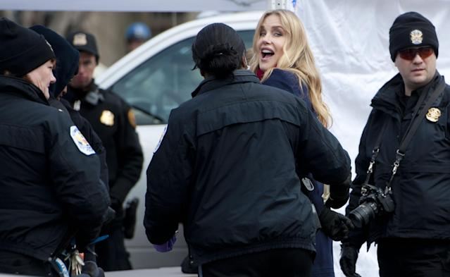 WASHINGTON, DC - FEBRUARY 13: Daryl Hannah is handcuffed and arrested during the Keystone XL Pipeline Protest at Lafayette Park on February 13, 2013 in Washington, DC. (Photo by Leigh Vogel/Getty Images)