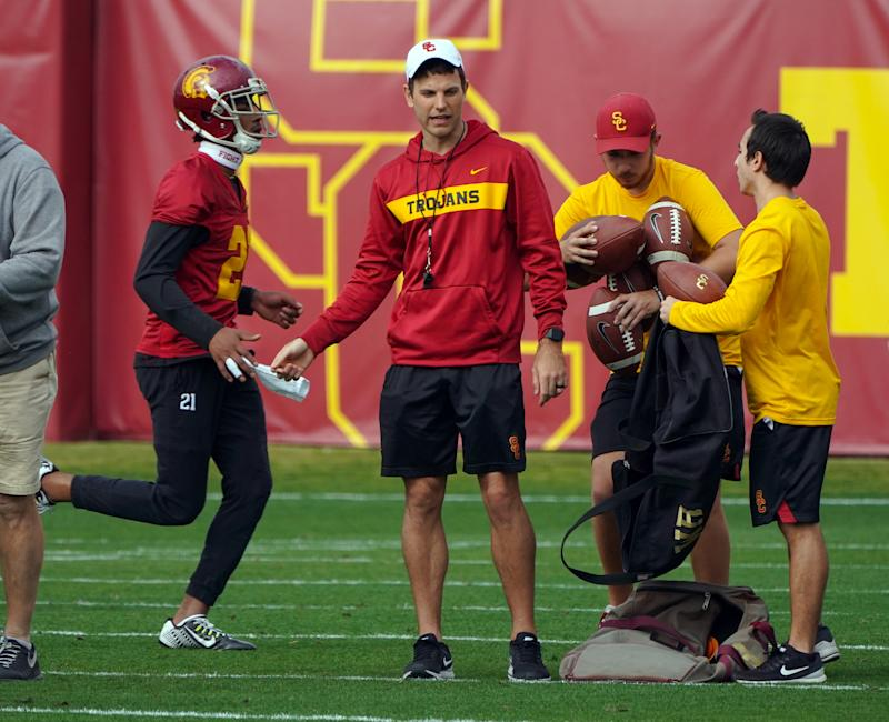Offensive coordinator Graham Harrell, center, works with the offense during USC's first spring football practice on campus in Los Angeles on Tuesday, Mar. 5, 2019. (Getty)