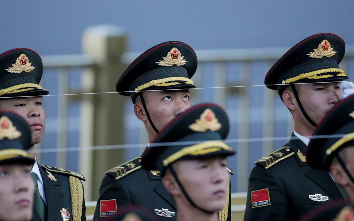 Members of the honour guard attend a welcome ceremony in Beijing - REUTERS