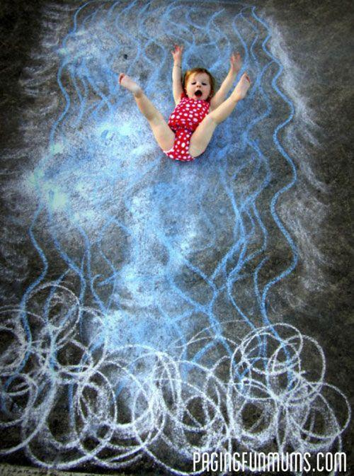 """<p>You don't need to be a skillful artist to make this fun chalk art photo backdrop: To create the look of a roaring river carrying your kiddo on a white-water adventure, just make wavy blue lines swishing into white swirls.</p><p><em><a href=""""https://pagingfunmums.com/2012/11/30/the-chalk-art-craze/"""" rel=""""nofollow noopener"""" target=""""_blank"""" data-ylk=""""slk:Get the tutorial from Paging Fun Mums »"""" class=""""link rapid-noclick-resp"""">Get the tutorial from Paging Fun Mums »</a></em></p>"""