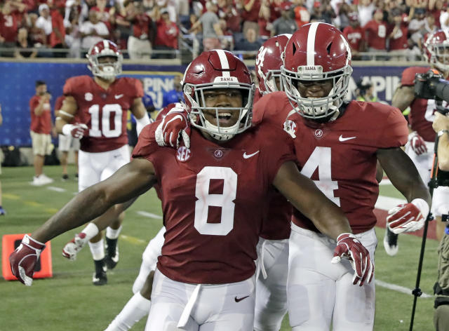 Alabama's Josh Jacobs (8) celebrates his touchdown run against Louisville with teammates, including wide receiver Jerry Jeudy (4), during the second half of an NCAA college football game Saturday, Sept. 1, 2018, in Orlando, Fla. (AP Photo/John Raoux)