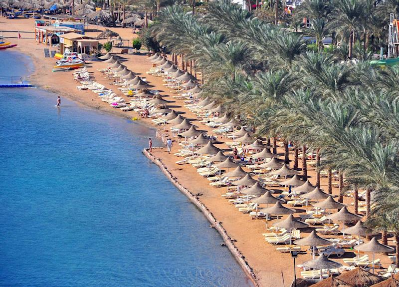 A general view showing a partially empty beach at the Red Sea resort of Sharm el Sheik, Egypt, Thursday, Dec. 2, 2010. An oceanic white tip shark badly mauled four Russian tourists swimming close to their beach hotels in two separate attacks at an Egyptian Red Sea resort, a local conservation official said. (AP Photo/Hussien Talal)