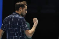 Daniil Medvedev of Russia gestures to a television camera after he wins match point against Dominic Thiem of Austria during their singles final tennis match at the ATP World Finals tennis tournament at the O2 arena in London, Sunday, Nov. 22, 2020. (AP Photo/Frank Augstein)