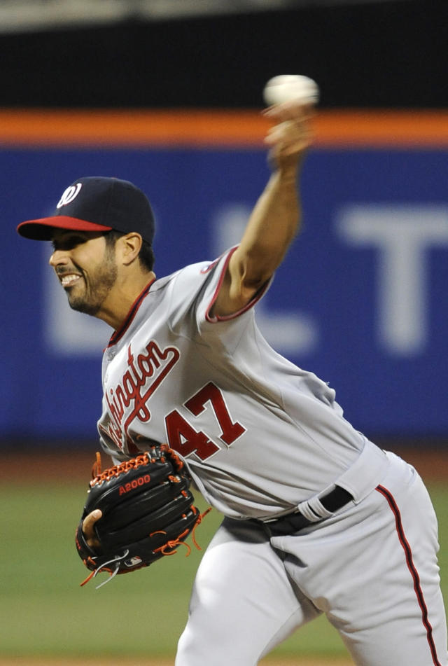 Washington Nationals starting pitcher Gio Gonzalez throws against the New York Mets in the first inning of a baseball game at Citi Field on Wednesday, April 2, 2014, in New York. (AP Photo/Kathy Kmonicek)