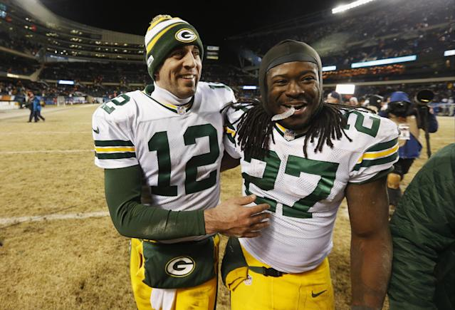 Green Bay Packers quarterback Aaron Rodgers (12) celebrates with running back Eddie Lacy (27) after their NFL football game against the Chicago Bears, Sunday, Dec. 29, 2013, in Chicago. The Packers won 33-28 to capture the NFC North title. (AP Photo/Charles Rex Arbogast)