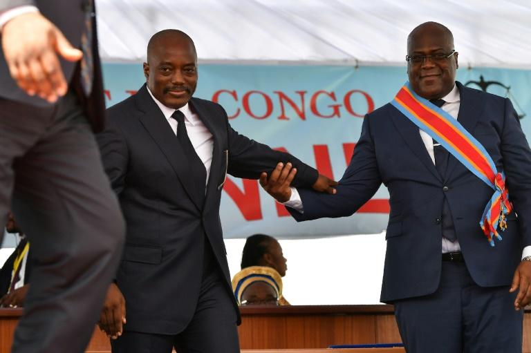 Inauguration day: Outgoing president Joseph Kabila, left, and successor Felix Tshisekedi mark DR Congo's first-ever peaceful transition of power. Kabila still overshadows the national political scene, wielding clout acquired during 18 years in office