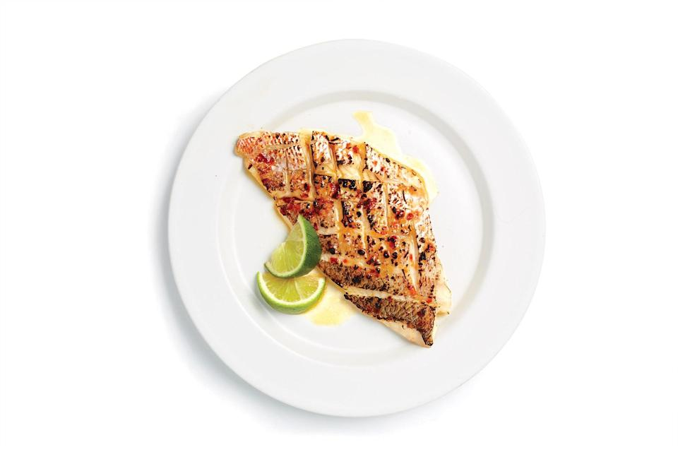 "The broiler is your friend. Scoring the fish ensures maximum crispy bits. <a href=""https://www.bonappetit.com/recipe/red-snapper-with-sambal?mbid=synd_yahoo_rss"" rel=""nofollow noopener"" target=""_blank"" data-ylk=""slk:See recipe."" class=""link rapid-noclick-resp"">See recipe.</a>"