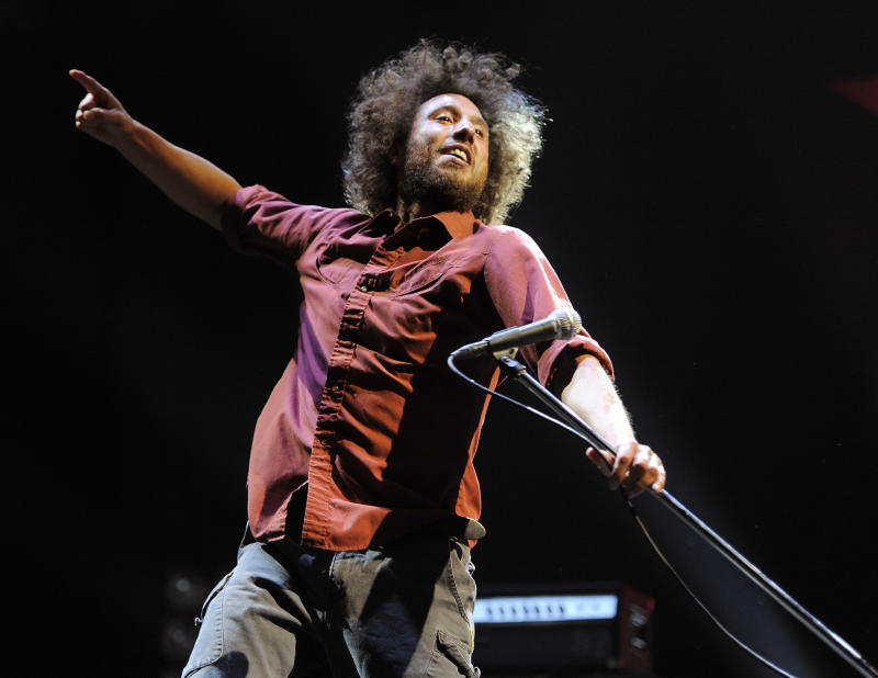 "Zack de la Rocha of the band Rage Against the Machine performs during the band's set at the ""L.A. Rising"" concert at the Los Angeles Coliseum, Saturday, July 30, 2011, in Los Angeles. (AP Photo/Chris Pizzello)"