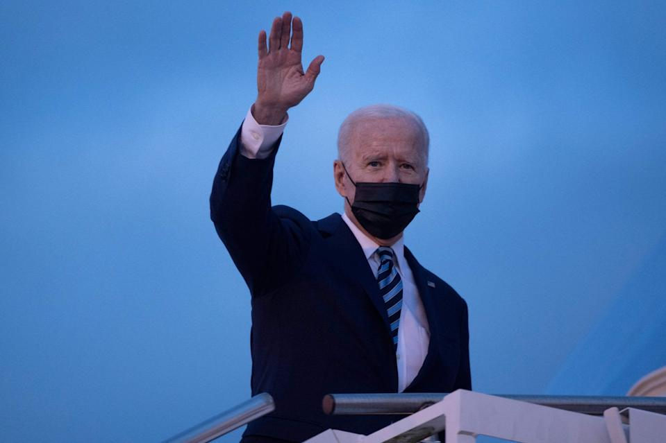 President Joe Biden waves as he boards Air Force One prior to his departure from Royal Air Force Mildenhall, England on Wednesday.