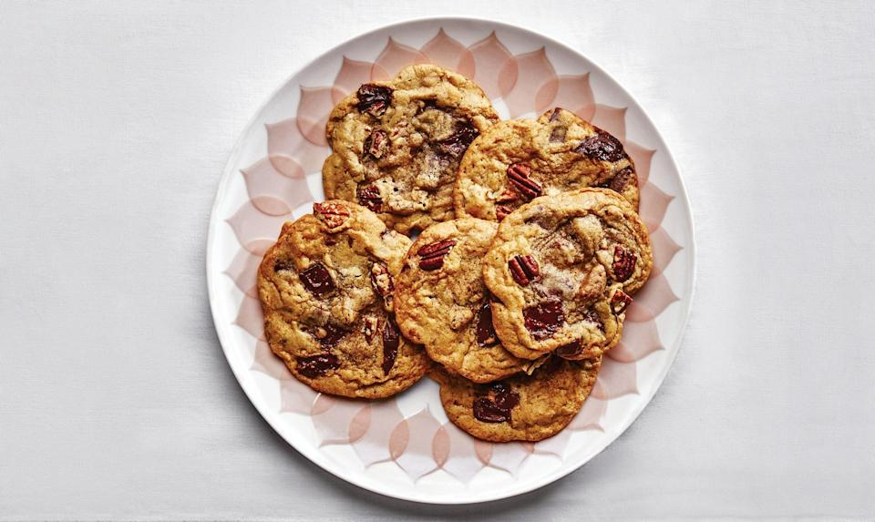 """Meet the Holiday Triple Threat Cookie,"" says Amanda. It's a chocolate chip cookie spiked with homemade pumpkin spice, crunchy pecans, and gooey pumpkin puree. <a href=""https://www.bonappetit.com/recipe/pecan-pumpkin-spice-chocolate-chip-cookies?mbid=synd_yahoo_rss"" rel=""nofollow noopener"" target=""_blank"" data-ylk=""slk:See recipe."" class=""link rapid-noclick-resp"">See recipe.</a>"
