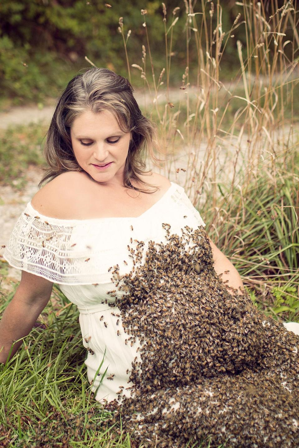 """<p>""""Then I put the queen bee in a cage and tied it to a branch in a tree in the garden. She is larger and bigger so it was easy to identify her."""" <br><em>[Photo: SWNS]</em> </p>"""