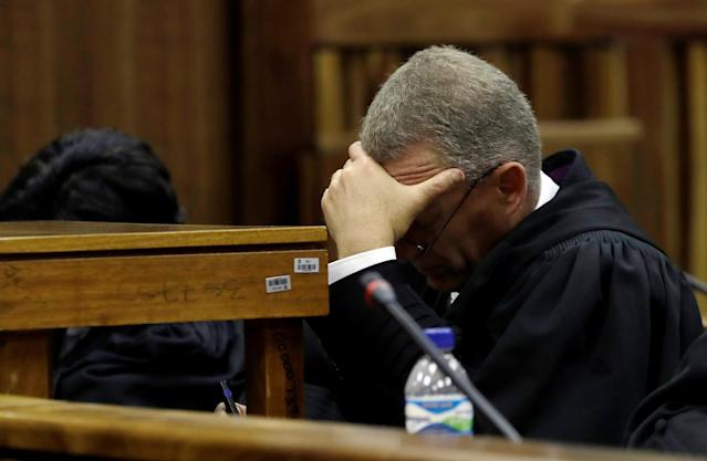 State prosecutor Gerrie Nel looks down as Judge Thokozile Masipa reads her verdict during an appeal hearing brought by prosecutors against the six-year jail term handed to Oscar Pistorius for the murder of his girlfriend Reeva Steenkamp in Johannesburg, South Africa, August 26, 2016. REUTERS/Themba Hadebe/Pool
