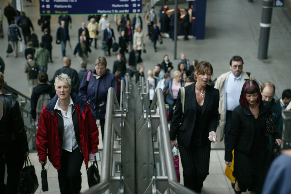 Rush hour at Leeds station as travellers ascend the station overbridge. May 2005, United Kingdom. (Photo by Rail Photo/Construction Photography/Avalon/Getty Images)