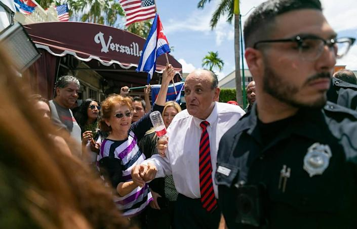 Former New York City Mayor Rudy Giuliani departs after holding a press conference outside of the Versailles Restaurant in Miami's Little Havana neighborhood on Monday, July 26, 2021. Giuliani spoke in support of the protests happening in Cuba.