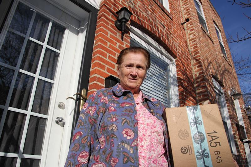 "Baltimore resident Rosemarie Dumhart, 79, uses a decoy package, marked with an X, to discourage the so-called ""porch pirates"" operating in the Canton area of Baltimore, Maryland, on December 17, 2018. - The thieves are filmed by a camera located above the door at the house. (Photo by Sébastien DUVAL / AFP) (Photo credit should read SEBASTIEN DUVAL/AFP via Getty Images)"