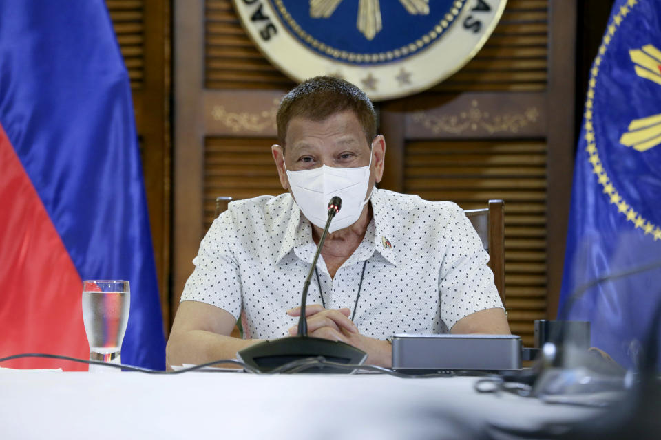 FILE PHOTO: In this photo provided by the Malacanang Presidential Photographers Division, Philippine President Rodrigo Duterte wears a protective mask as he meets members of the Inter-Agency Task Force on the Emerging Infectious Diseases in Davao province, southern Philippines. (Albert Alcain/Malacanang Presidential Photographers Division via AP)