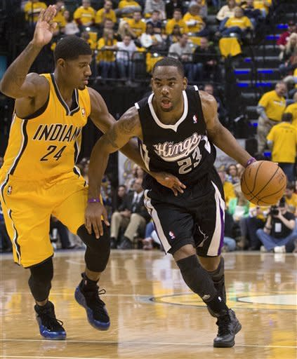 Sacramento Kings' Marcus Thornton presses the ball into the lane against Indiana Pacers' Paul George during an NBA basketball game in Indianapolis on Saturday, Nov. 3, 2012. (AP Photo/Doug McSchooler)
