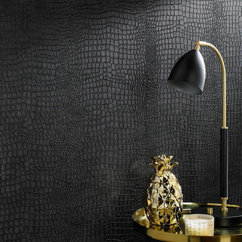 """This gorgeous, textured wallpaper is an ode to luxury. It would work equally well in an office, bedroom, glamorous bathroom, or an entryway in need of a little drama. This elevated style is a hallmark of Graham & Brown. In addition to moody offerings like this one, they also have a variety of options on the lighter side of things, including spirited chevon, quirky florals, metallic botanicals, chunky stripes, and versatile tessellations. $85, Graham & Brown. <a href=""""https://www.grahambrown.com/us/crocodile-black-wallpaper/32-659-master.html"""" rel=""""nofollow noopener"""" target=""""_blank"""" data-ylk=""""slk:Get it now!"""" class=""""link rapid-noclick-resp"""">Get it now!</a>"""