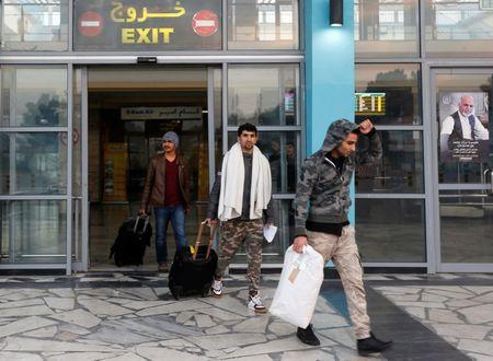 Afghans, whose asylum applications have been rejected, arrive from Germany in Kabul airport