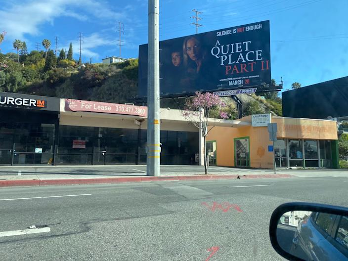 Though time moves forward, the billboards in Los Angeles, California, stay frozen in time.