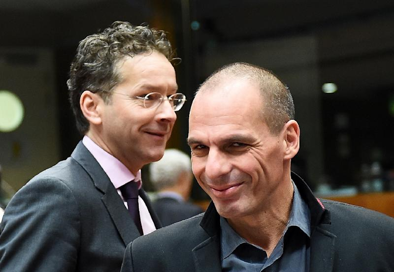 Greece's Finance Minister Yanis Varoufakis (R) and Eurogroup President Jeroen Dijsselbloem arrive to take part in a European economic and financial affairs (ECOFIN) meeting at the European Council in Brussels, on February 17, 2015 (AFP Photo/Emmanuel Dunand)