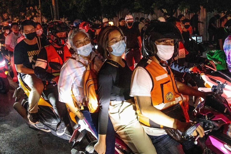 Motorcycle taxi riders ferrying protesters after a rally in Bangkok. Photo: AFP