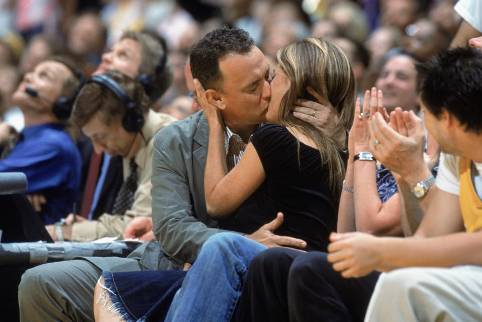 Hanks and Wilson share a kiss courtside at a 2004 Los Angeles Lakers game. (Photo: Andrew D. Bernstein /NBAE via Getty Images)