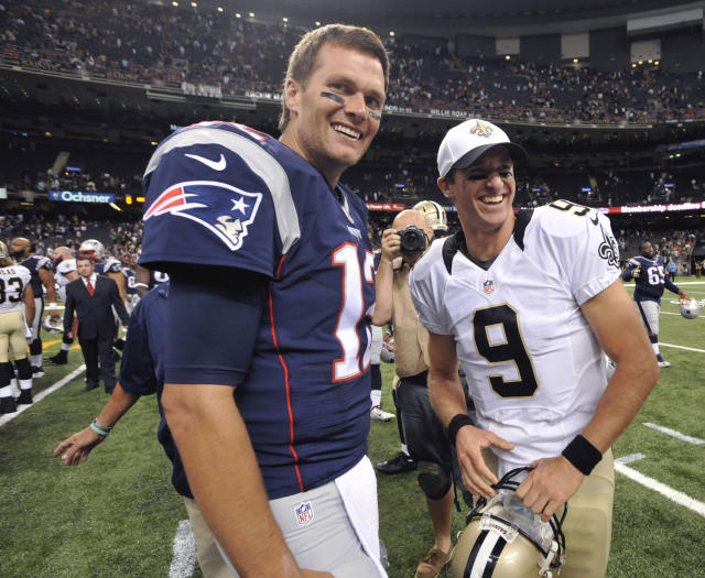 Tom Brady and Drew Brees will meet again twice this season. (AP Photo/Bill Feig)