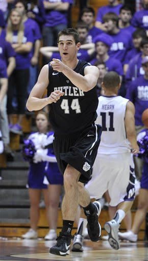 Butler's Andrew Smith (44) points after scoring against Northwestern during the second half of an NCAA college basketball game Saturday, Dec. 8, 2012, in Evanston, Ill. Butler defeated Northwestern 74-65. (AP Photo/Jim Prisching)