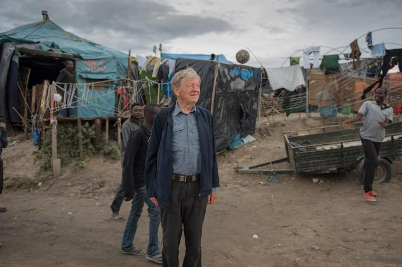 Lord Alf Dubs, pictured in the Calais jungle, is among those to have shared his story after arriving in London as a child from Czechoslovakia (Help Refugees)